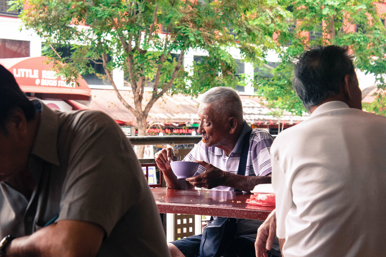 are you lonely Alone Bugis Canon Casual Clothing Eating Hawker Centre Holding Indoors  Leisure Activity Lifestyles Loneliness Lonely Melancholy Men Occupation Old Man Person Real People Singapore Sitting Street Life Streetphotography Togetherness Urbanphotography