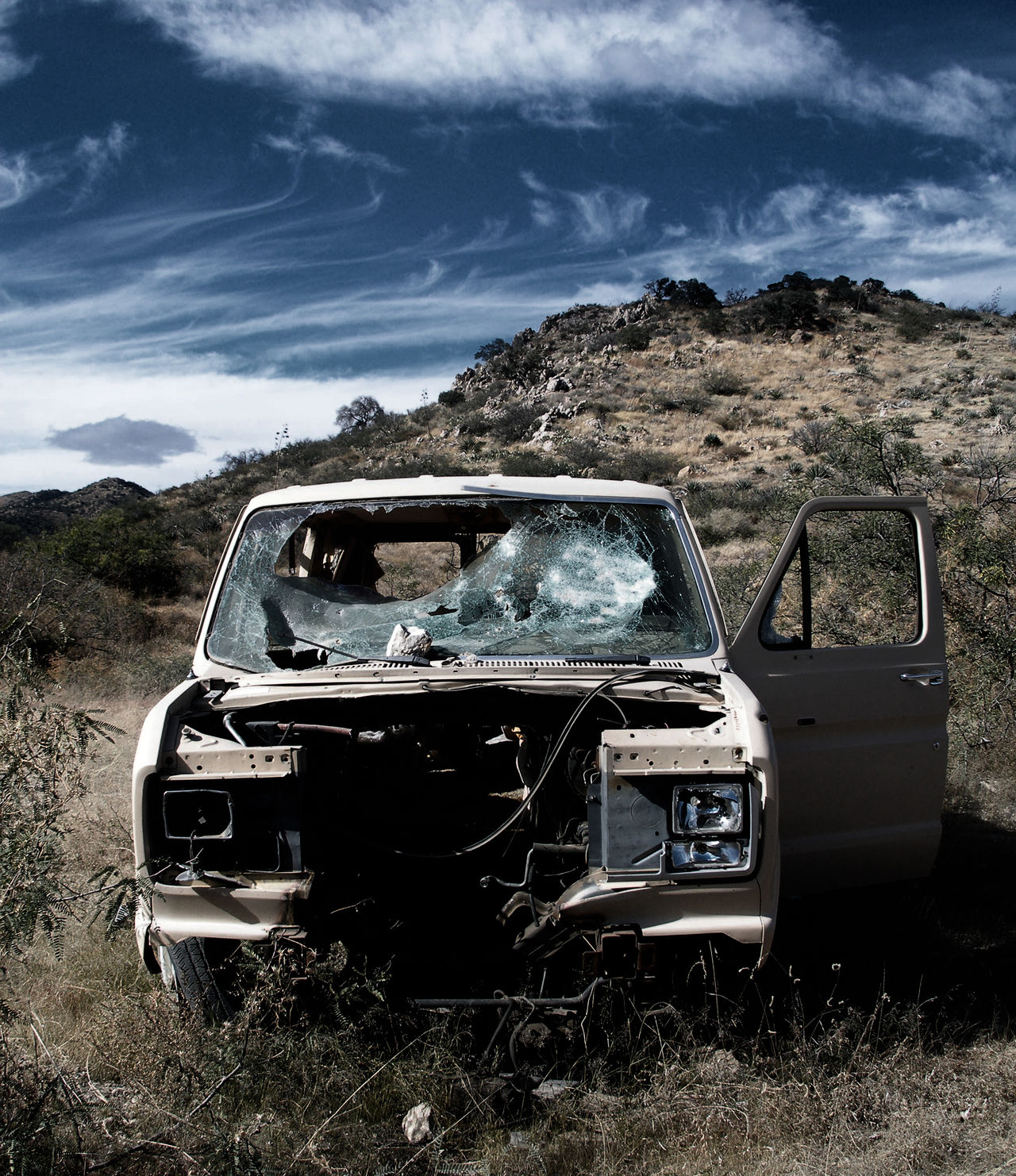 A car shot to death in the deep desert near Tucson, Arizona. Some people really hate parked cars. Beauty In Destruction Car Cloud - Sky Desert Landscape Destruction Can Be Beautiful Gun Shot Landscape Non-urban Scene Outdoors Remote Sky