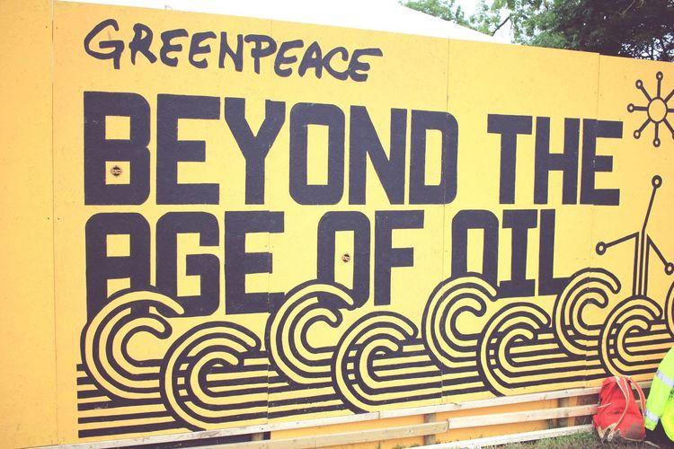 Glastonbury Music Festival Greenpeace Oil Signage at Glastonbury Festival