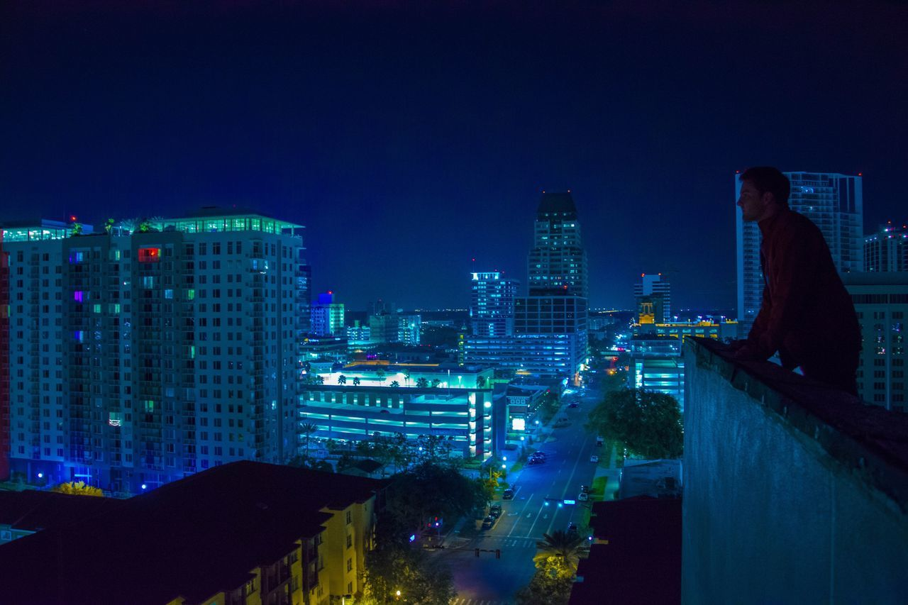 Beauty Illuminated Architecture Night Building Exterior City Blue Built Structure Modern Travel Destinations Skyscraper Cityscape Outdoors Sky Urban Skyline No People Black Background Dark Adult Nightlife Darkness Real People Only Women One Person Lifestyles
