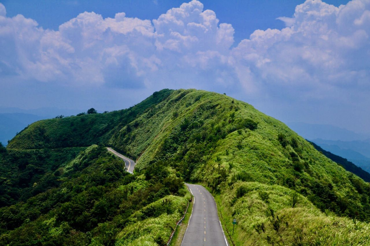 road, sky, cloud - sky, green color, the way forward, nature, transportation, scenics, beauty in nature, day, mountain, no people, tree, landscape, tranquility, outdoors, winding road