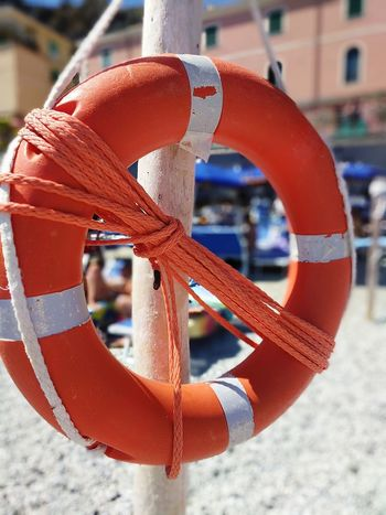 Beach Safety Ring Orange Color Chilling In The Sun Italy Cinque Terre Day Outdoors Close-up Focus On Foreground Break Time Rest Summer