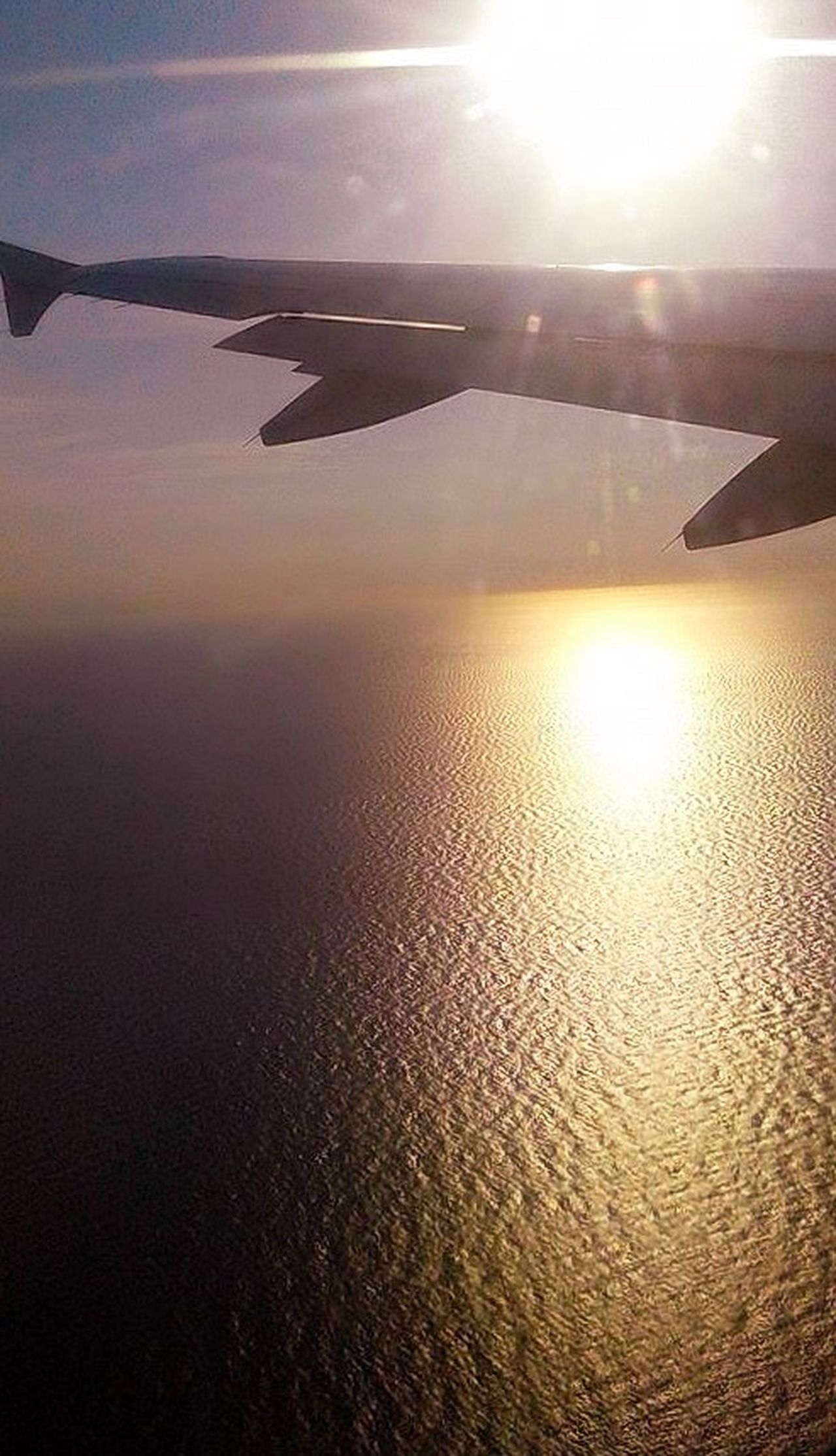 Cloud - Sky Horizon Over Water Lens Flare Ocean On The Plane ✈ Overhead View Reflection Sky Sunlight