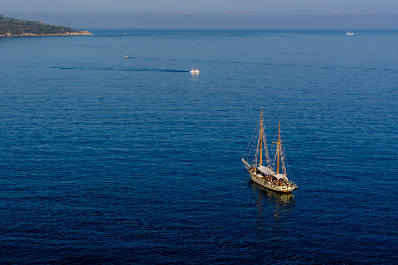 High Angle View Of Sailboat On Blue Sea