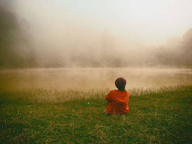 Beauty In Nature Casual Clothing Countryside Fog Getting Away From It All Grass Innocence Lake Lakeshore Leisure Activity Nature Non-urban Scene Rear View Relaxation Remote Scenics Solitude Sunrise - Dawn Tourism Tranquil Scene Tranquility Travel Travel Destinations Vacations Water
