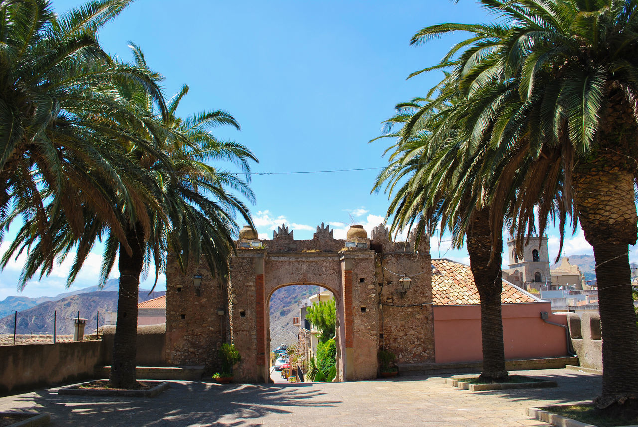 Arch Architecture Blue Sky City Clear Sky Cloister Clouds Convent Day Forza D'agrò History Italy Medieval Monuments No People Outdoors Palms Sicily Sky St. Augustine Travel Travel Destinations Trees