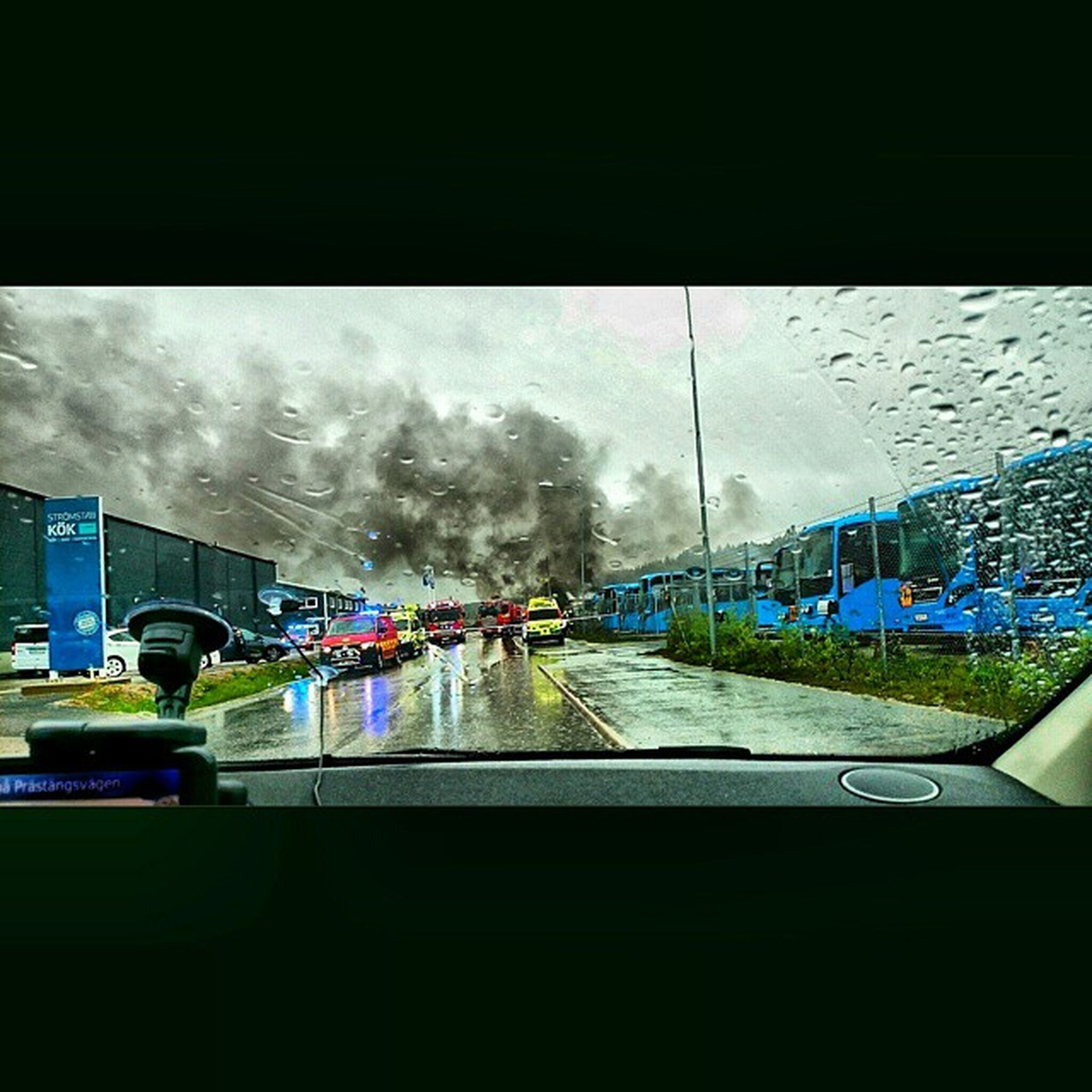 transportation, glass - material, transparent, vehicle interior, mode of transport, window, car, land vehicle, indoors, windshield, sky, road, car interior, rain, weather, wet, city, travel, looking through window, cloud - sky