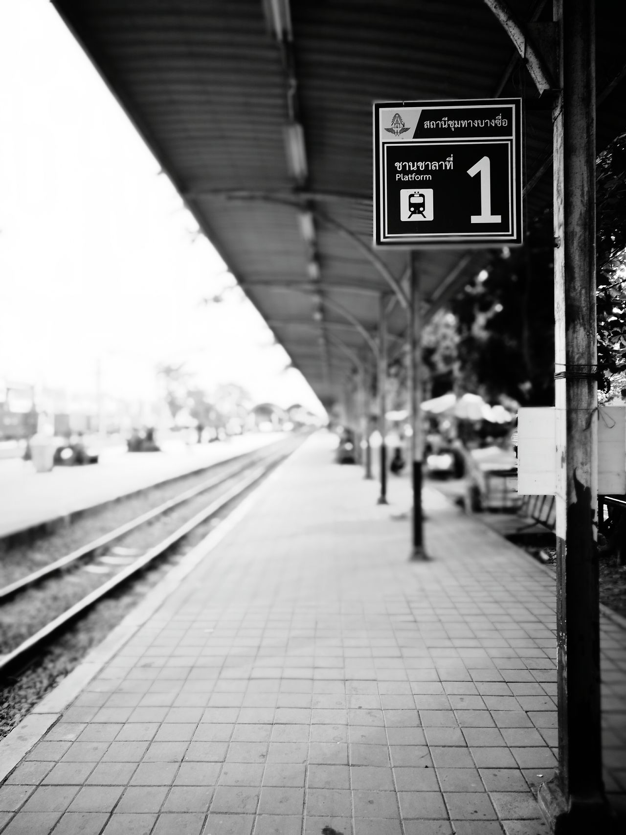 Focus On Foreground Travel Built Structure Exit Sign Text Railroad Station Platform Outdoors Day Road Sign Architecture People Adults Only Adult