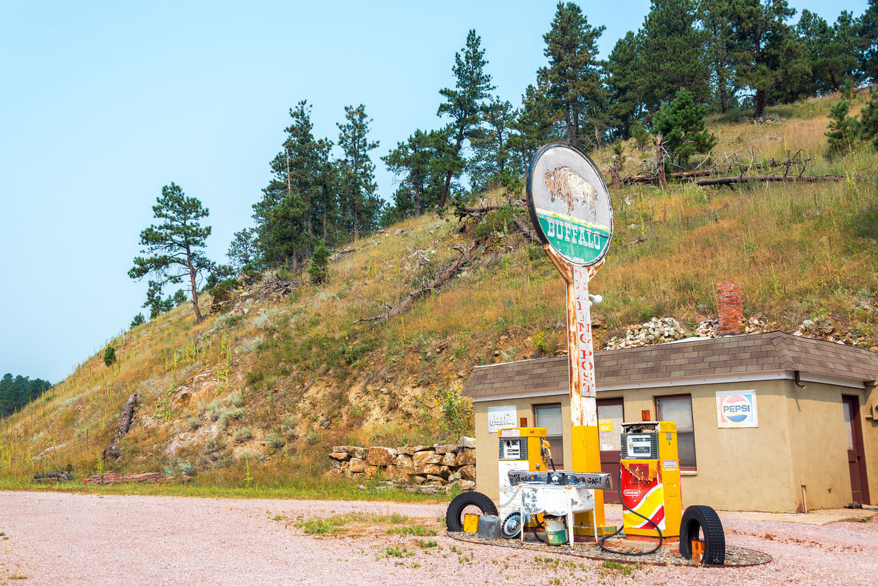 CUSTER, SD - AUGUST 28: Abandoned gas station near Custer, SD on August 28, 2015 Abandoned Black Hills Buffalo Day Derelict Gas Gas Station No People Old Outdoors Petrol Petrol Station Road Sign Sky South Dakota Tourism Travel Travel Destinations Tree USA