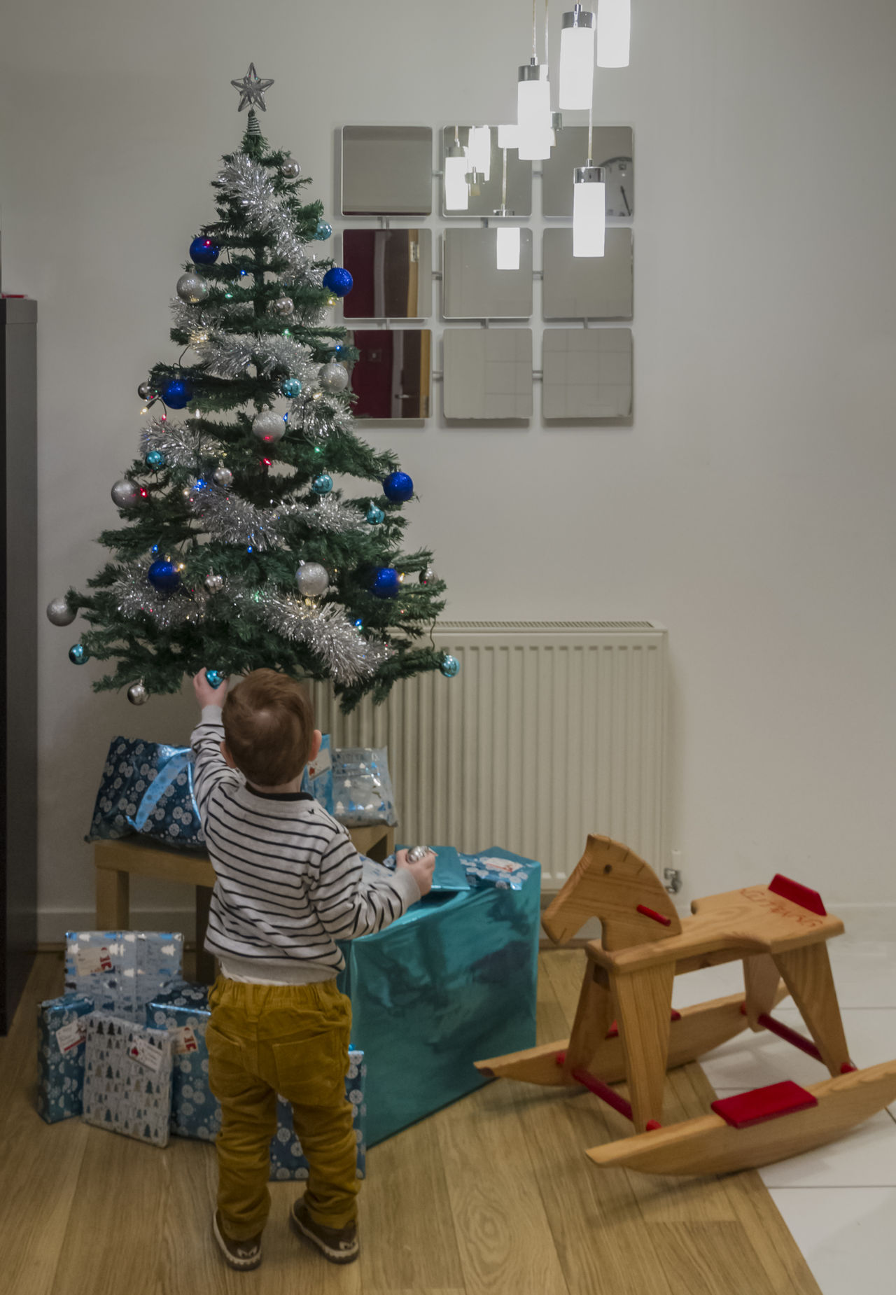 Anticipation Celebration Child Childhood Children Only Christmas Christmas Decoration Christmas Present Christmas Stocking Christmas Tree Domestic Life Full Length Gift Holiday - Event Home Interior Indoors  Living Room Males  My Year My View One Person People Toddler  Tradition Tree