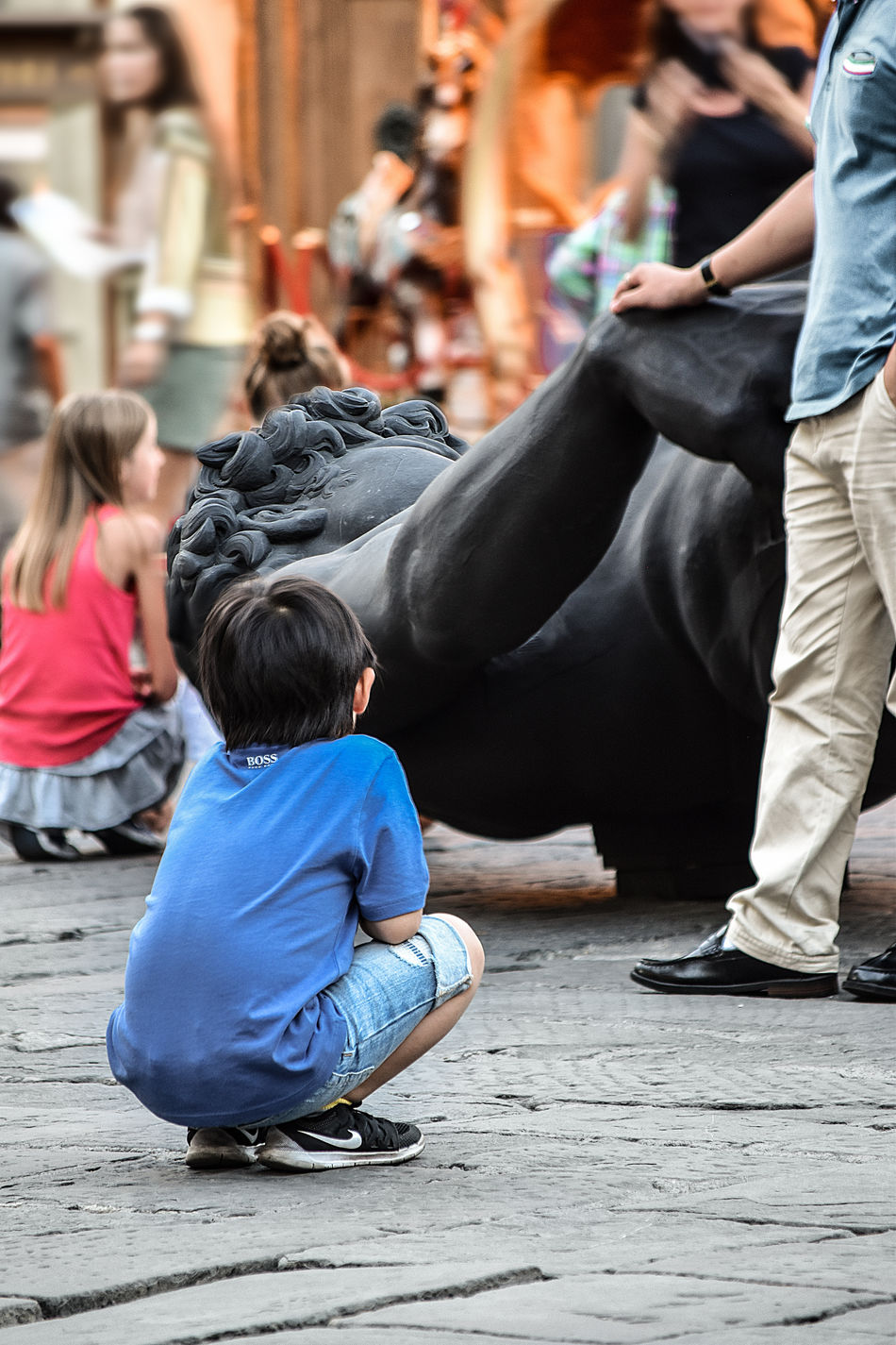 Bambini Che Giocano Black David For Nizza Black Marble Casual Clothing Children David For Nizza David Nero Day Florence Italy Focus On Foreground Leisure Activity Lifestyles Marble Men Outdoors Piazza Della Repubblica Firenze Selective Focus Sitting Square Tuscany Italy