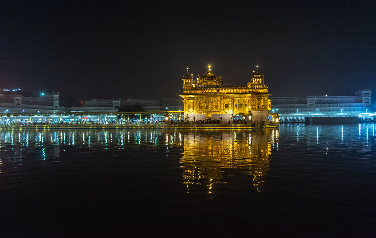 Beneath the beauty you see, there is a lot of action going on. Underneath it there are 5 sets of water filters and they filter 25,000 liters of water every minute and also compressed air is infused in water to keep it fresh. Technology and spirituality both work in harmony here. Golden Temple Harminder Sahib Architecture Night Illuminated Travel Destinations Reflection Built Structure Water Building Exterior Amritsar Enjoying Life Exceptional Photographs Taking Photos Punjab Gurdwara Architectural Column Place Of Worship Hinduism Buliding Nightphotography Night Lights Gold Sprituality Faith