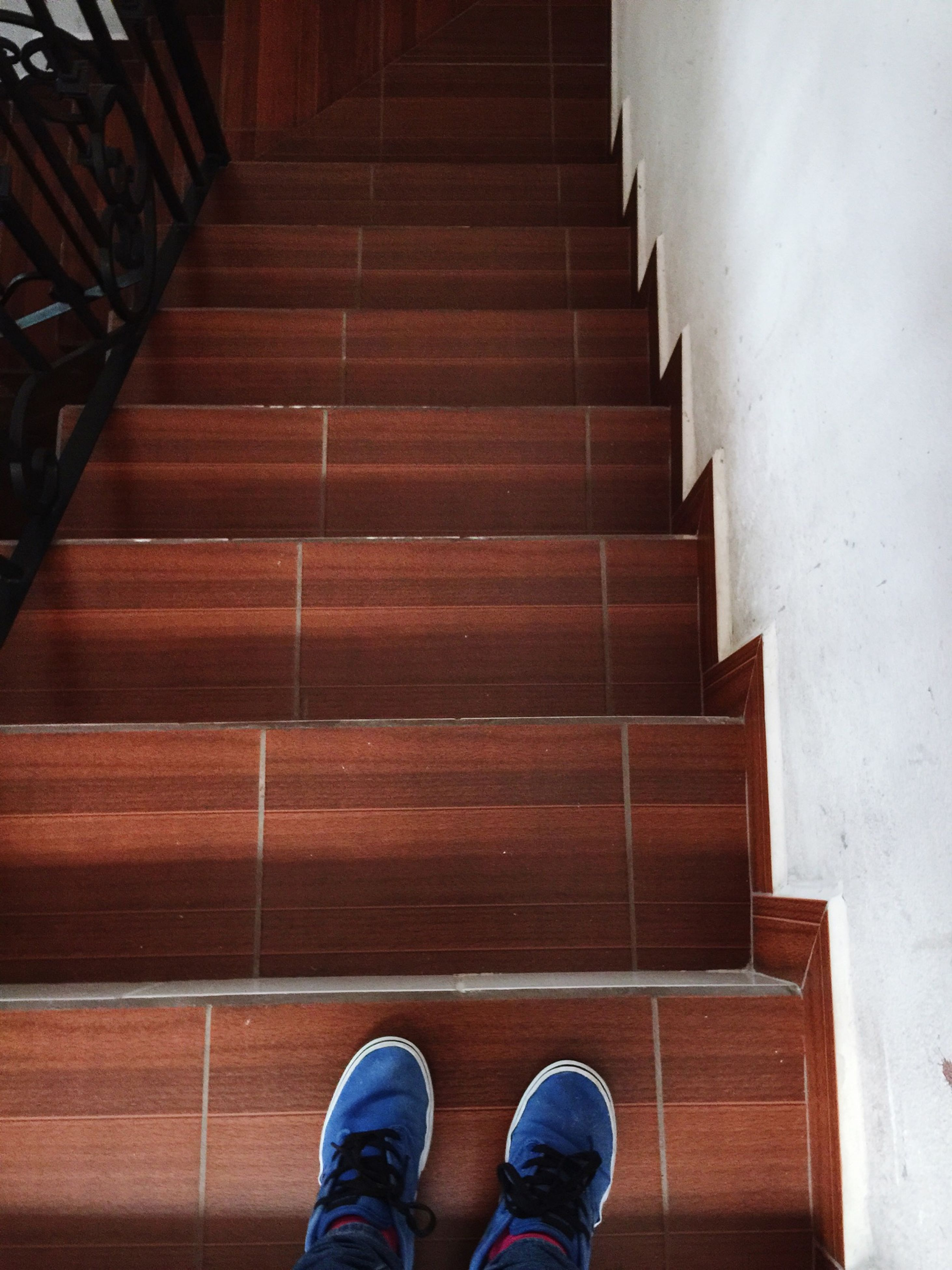 low section, person, shoe, personal perspective, steps, standing, human foot, steps and staircases, lifestyles, indoors, men, staircase, footwear, high angle view, unrecognizable person, stairs, directly above