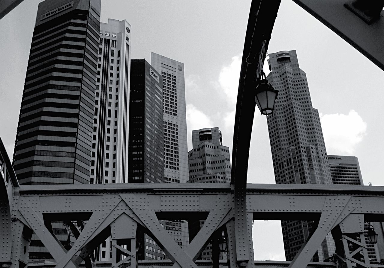 architecture, built structure, building exterior, low angle view, skyscraper, city, day, travel destinations, outdoors, communication, sky, modern, no people, cityscape