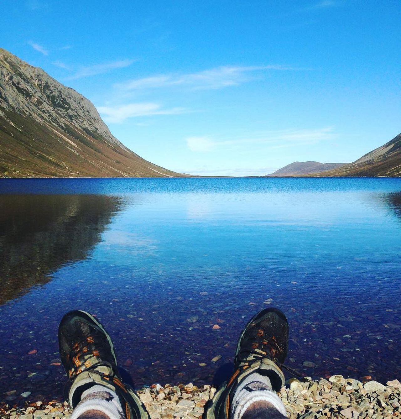 Low Section Sky Water Personal Perspective Reflection Blue One Person Shoe Scenics Nature Beauty In Nature Highlands Mountain Leisure Activity Human Leg Lifestyles Real People Outdoors Day Clear Water Hiking Camping Miles Away Loch Eanaich Loch