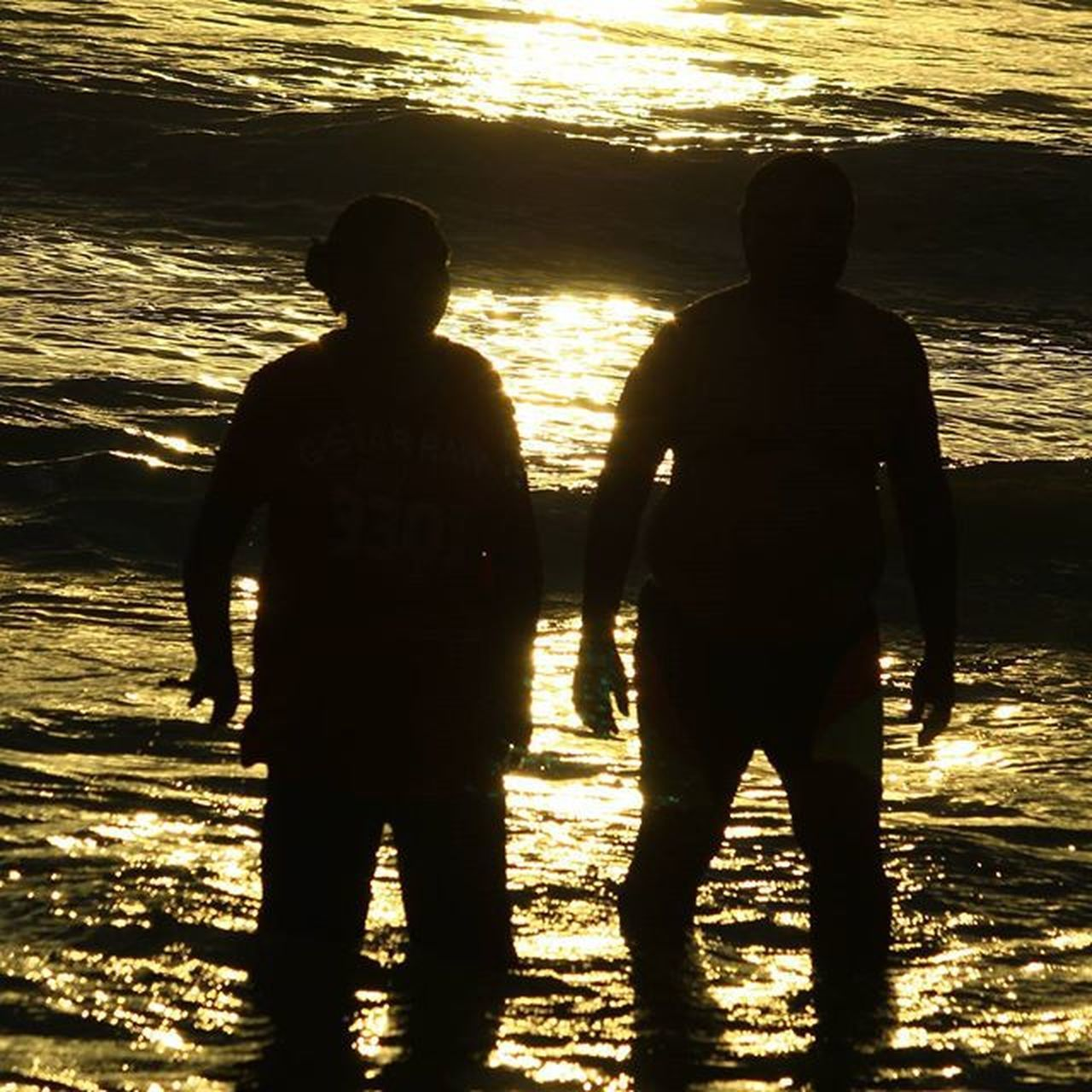 silhouette, two people, sunlight, sea, shadow, standing, sunset, togetherness, nature, men, beach, water, real people, outdoors, full length, beauty in nature, only men, people, friendship, adult, adults only, day