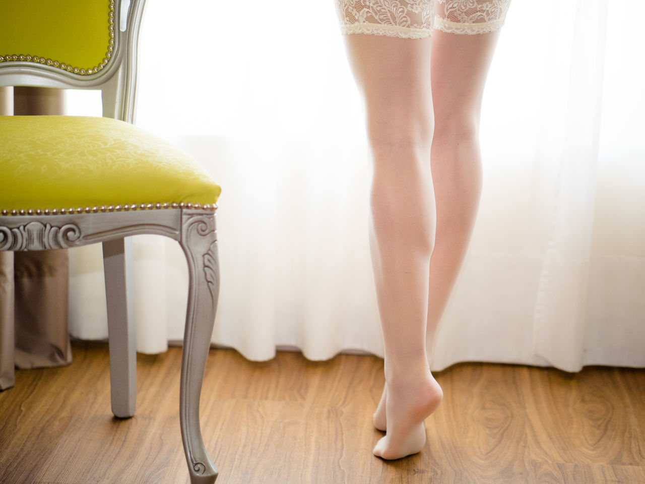 Woman wearing stockings in her bedroom Bedroom Close-up Day High Heels Human Body Part Human Leg Indoors  Legs Low Section One Person One Woman Only One Young Woman Only Only Women People Women Young Adult