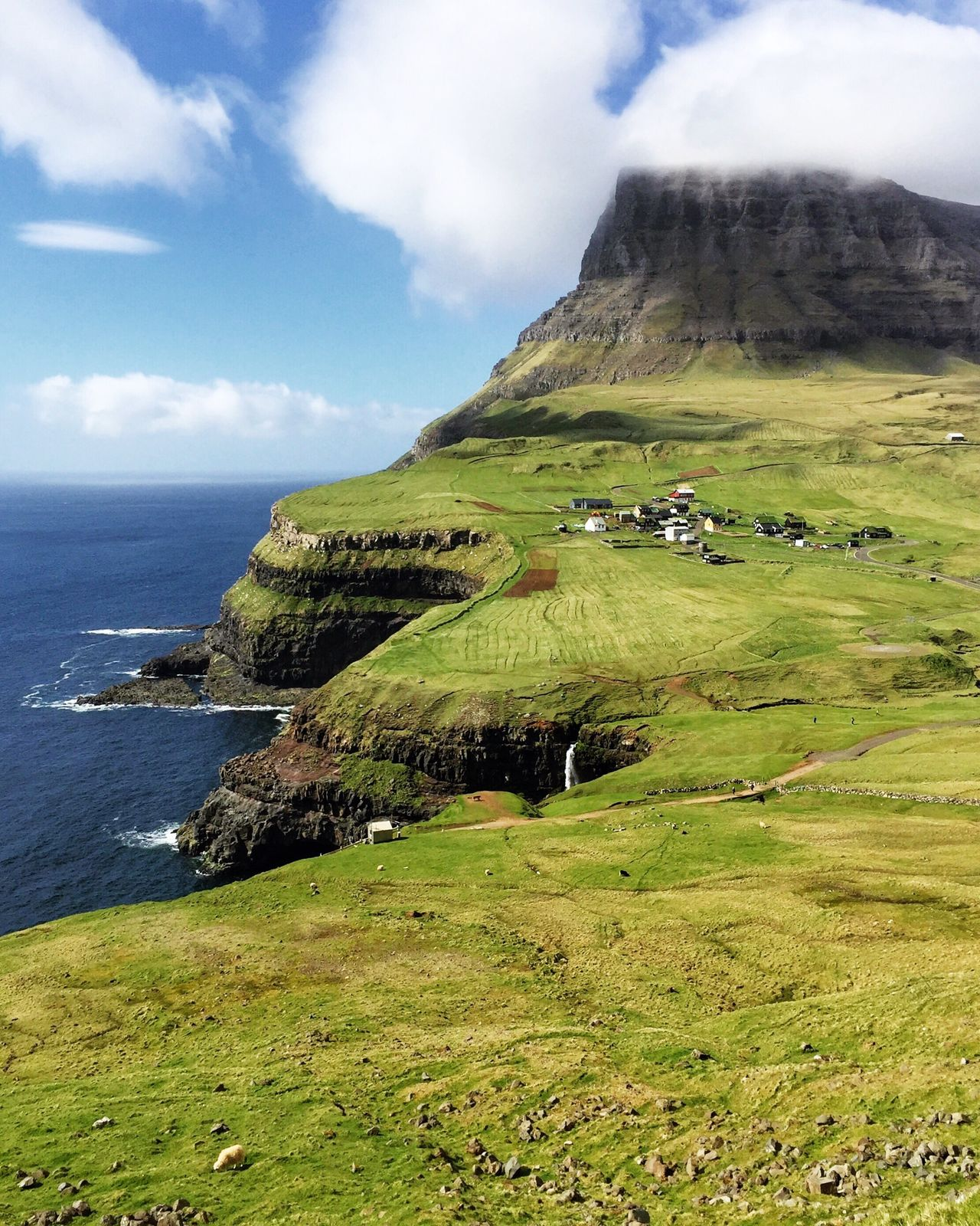 Gásadalur, The Faroe Island Beauty In Nature Faroe Islands Gasadalur Visit Faroe Islands Scenics Nature Waterfall Tranquil Scene Cloud - Sky Green Color Landscape No People Travel Destinations