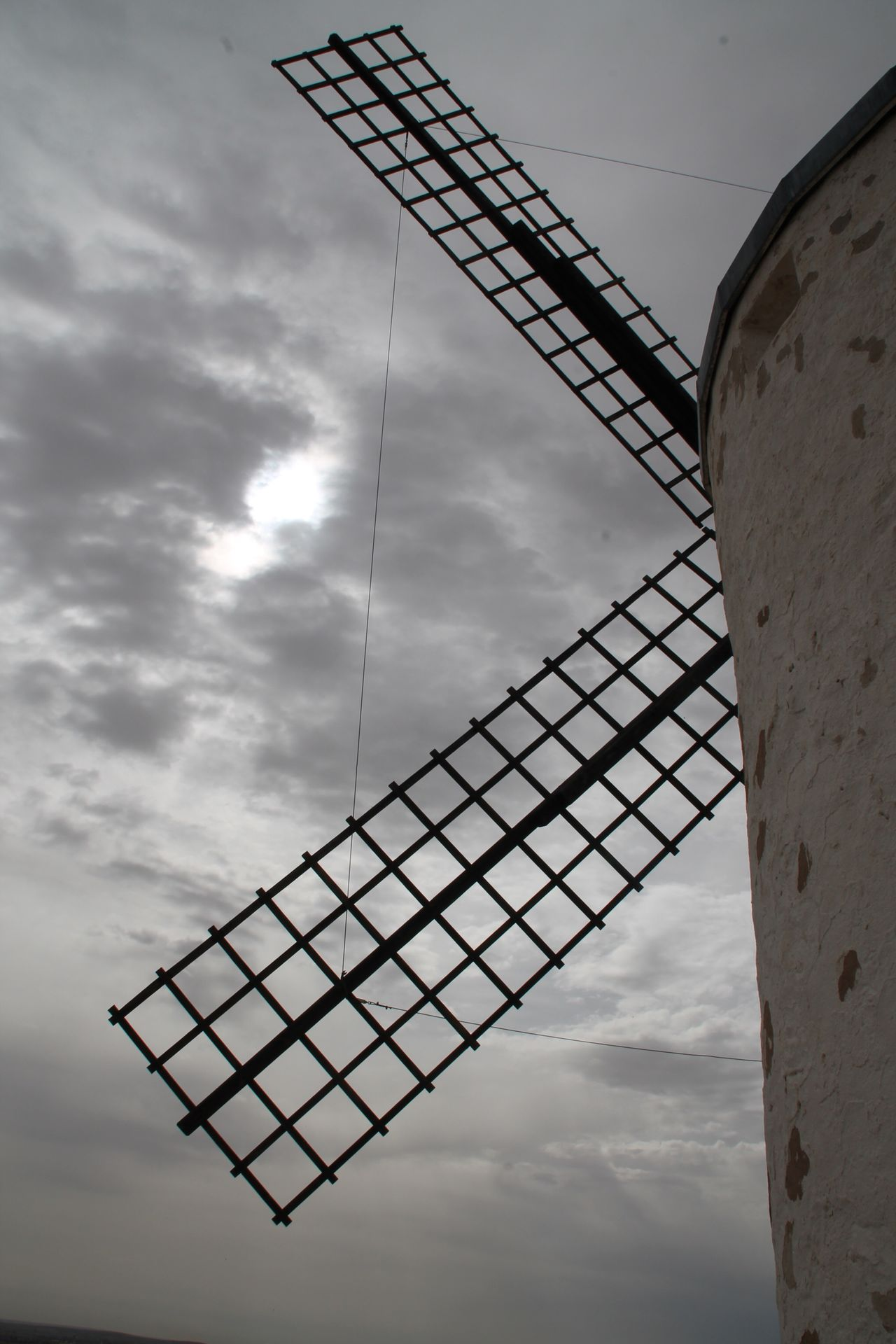 Sky Low Angle View Cloud - Sky Architecture No People Built Structure Day Outdoors Windmill Wind Power Wind Power Windmill Consuegra La Mancha Taking Photos Check This Out Traditional Windmill Travel Destinations Hanging Out Rural Scene Building Exterior Architecture Sky And Clouds Nature Rear View