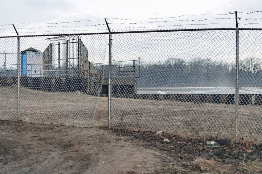 Industry Chainlink Fence Day Field Forest Industrial Landscapes No People Outdoors Prison Protection Safety Security Sky