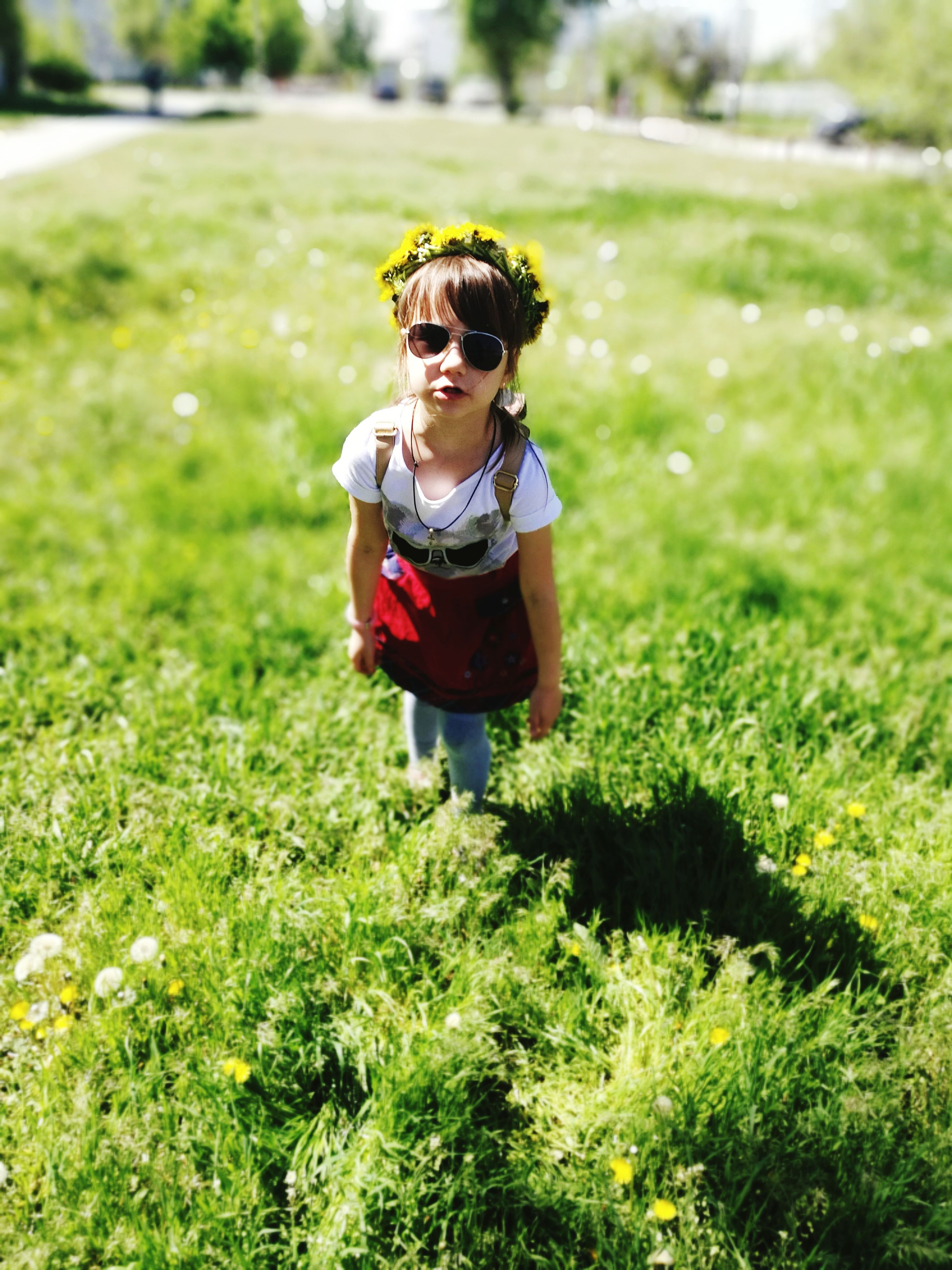 grass, childhood, real people, field, one person, day, elementary age, walking, outdoors, full length, green color, lifestyles, boys, growth, nature, standing, flower, people