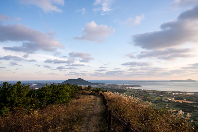 ASIA Jeju Korea Mountain View Beauty In Nature Cloud - Sky Crater Day Grass Horizon Over Water Jejuisland Landscape Mountain Nature No People Outdoors Scenics Sea Sky The Way Forward Tranquil Scene Tranquility Volcano Water EyeEm Ready   EyeEmNewHere