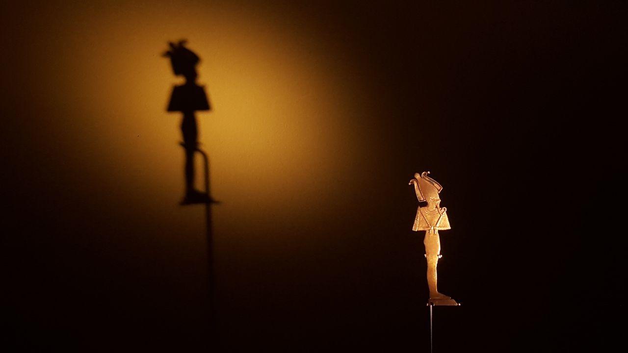 Art Dark Egypt Human Representation Illuminated Lighting Equipment Osiris Religion Sculpture Silhouette Spirituality Statue