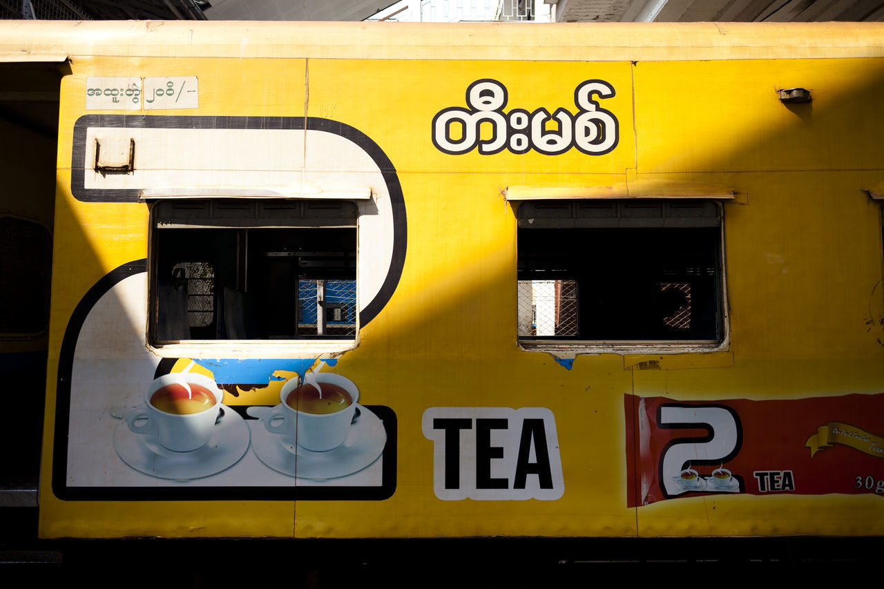 A colourful train at the station in Yangon, Myanmar. Colourful Communication Day Myanmar Public Transportation Signs Train Train Front Travel Travel Photography Window Yellow Yellow Color