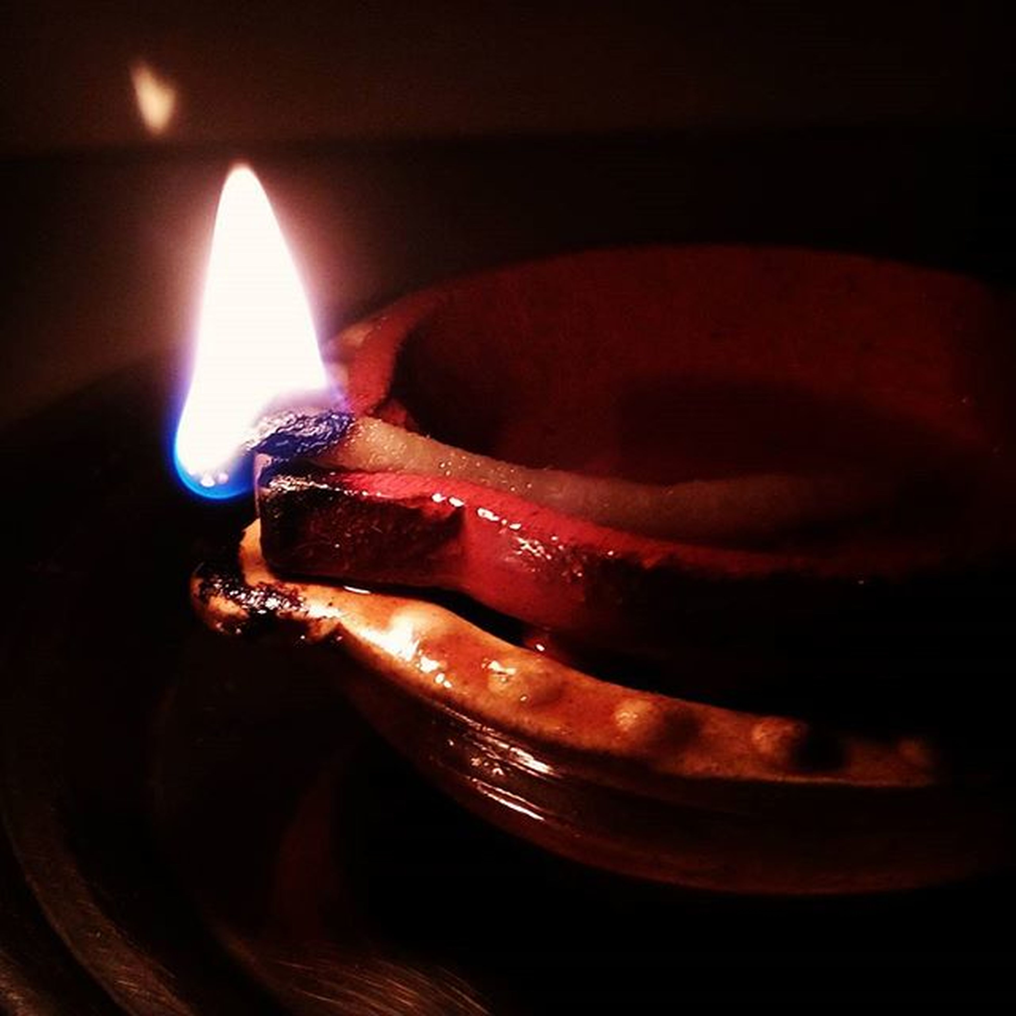 indoors, burning, flame, fire - natural phenomenon, heat - temperature, candle, illuminated, close-up, glowing, still life, lit, red, night, fire, candlelight, light - natural phenomenon, black background, dark, no people, selective focus