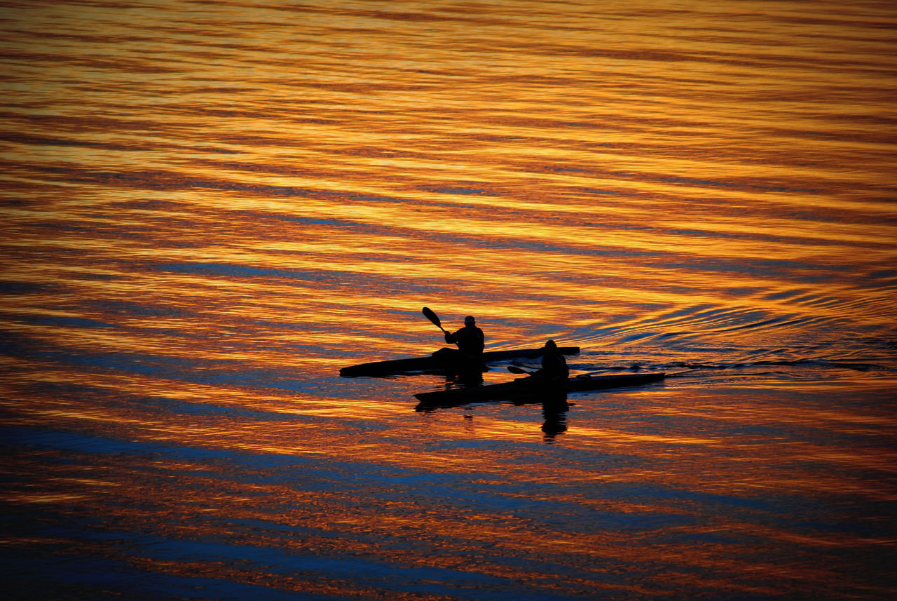 water, sunset, silhouette, nature, two people, sea, real people, waterfront, men, leisure activity, transportation, beauty in nature, nautical vessel, togetherness, outdoors, tranquility, scenics, lifestyles, standing, sitting, rowing, sailing, jet boat, day, sky, adult, people