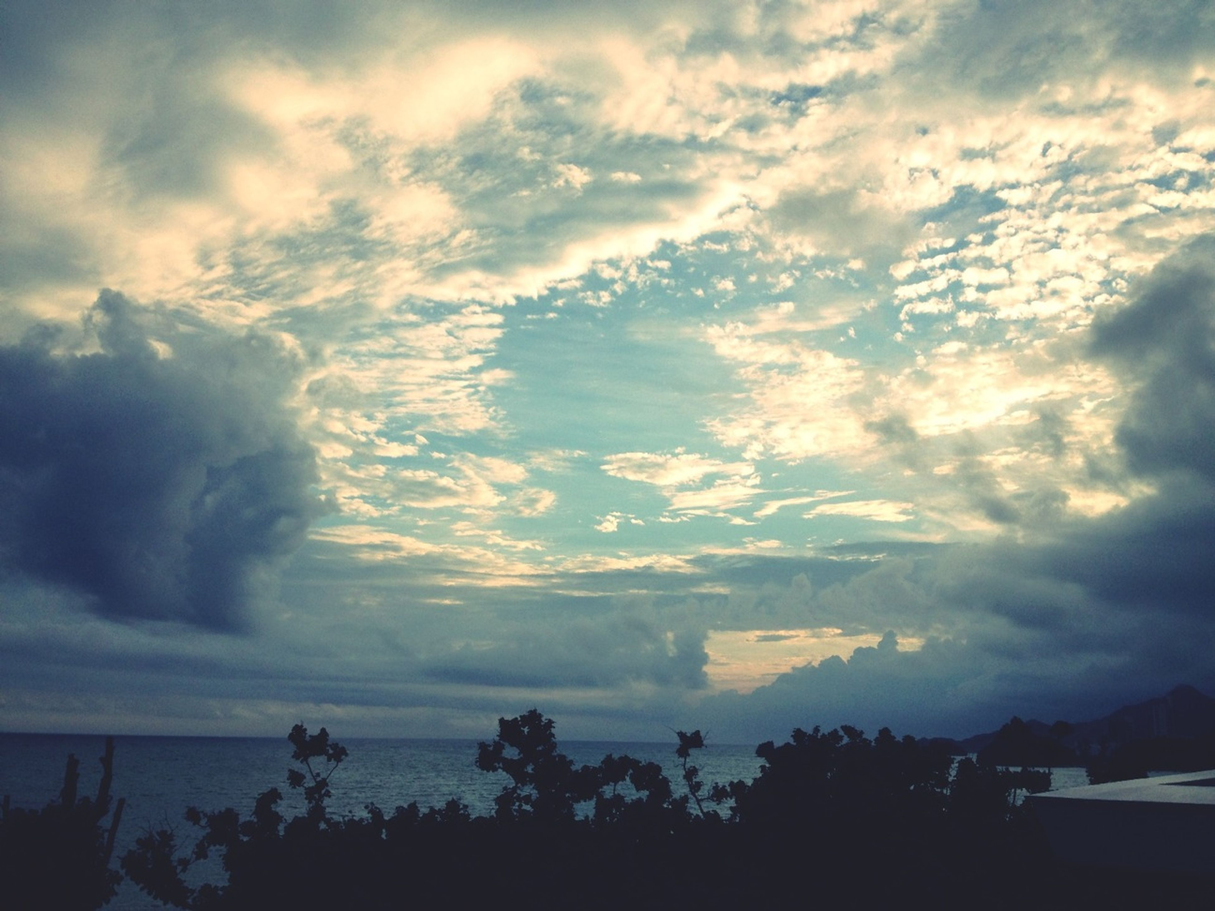 sky, cloud - sky, tranquil scene, cloudy, tranquility, scenics, beauty in nature, silhouette, tree, nature, weather, cloud, cloudscape, overcast, idyllic, landscape, outdoors, no people, dusk, dramatic sky