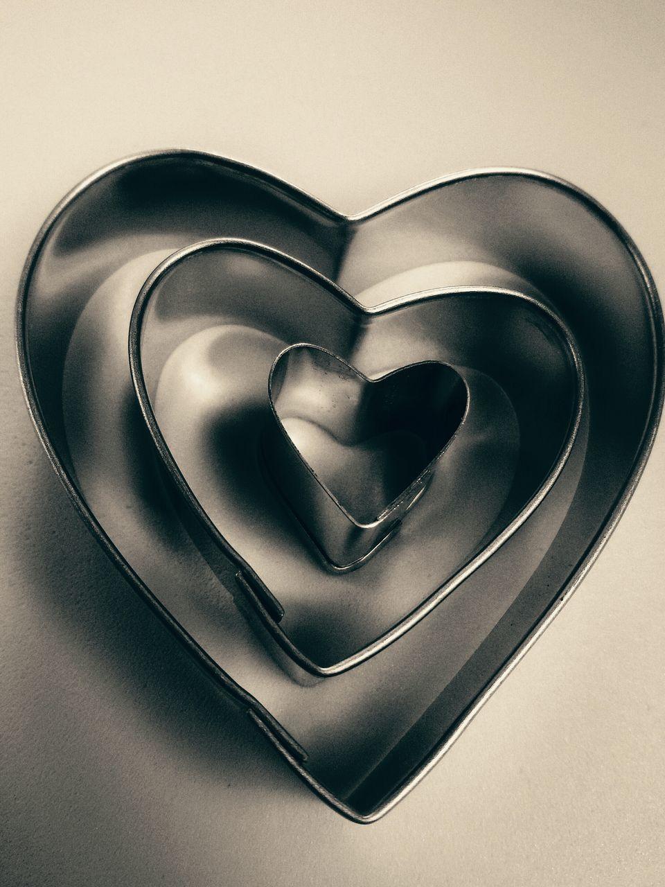Three Heart-Shaped Baking Cutters Arranged In Size