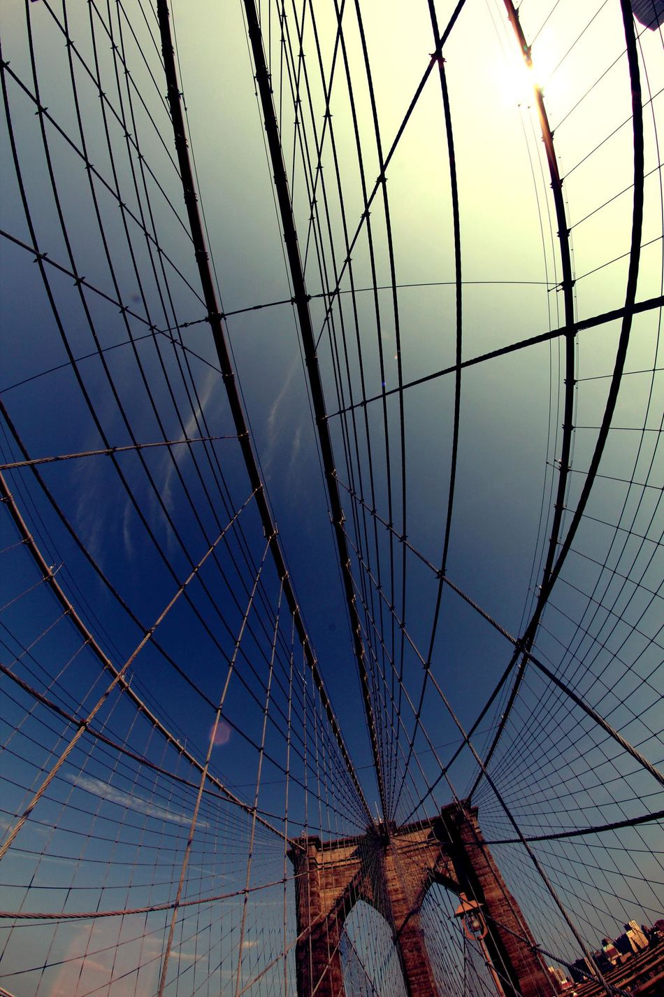 Fish eye view of one of the pillars of the famous Brooklyn Bridge in New York city Architecture Big Apple Bridge - Man Made Structure Brooklyn Bridge  Brooklyn Bridge / New York Building Exterior Built Structure City Connection Fisheye Low Angle View Modern New York New York City No People NYC NYC Photography Outdoors Sky Suspension Bridge Travel Destinations Urban Urban Skyline USA