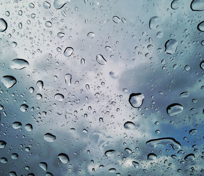 Raindrops keep falling on my head Raindrops Drop Close-up Sky Wet Rain Focus On Foreground Beauty In Nature Freshness Water Drop Cloud Rainy Day Rainy Weather Water Season  Bedweather Background Backgrounds