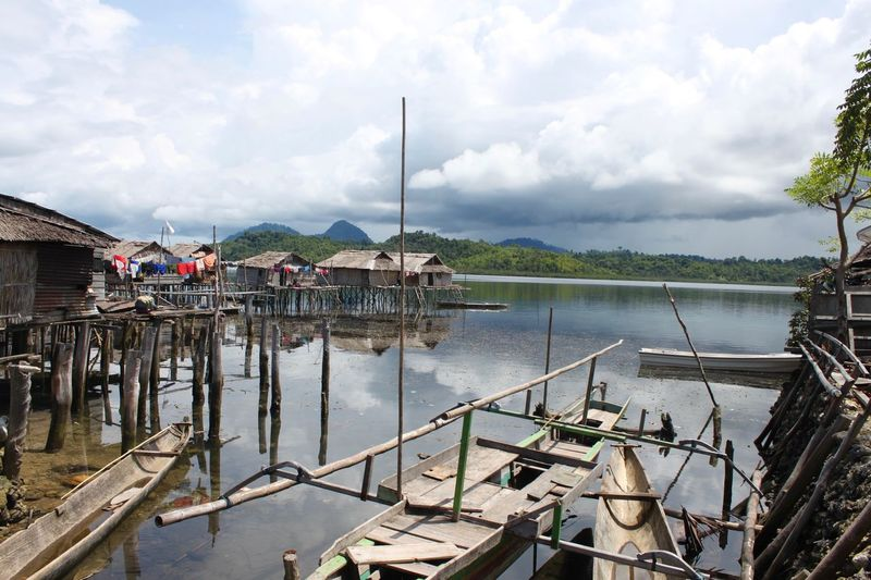 Sulawesi Architecture Beauty In Nature Building Exterior Built Structure Cloud - Sky Day Nature Nautical Vessel No People Outdoors Scenics Sea Sea Gypsy Village Sky Togian Islands... Tree Water