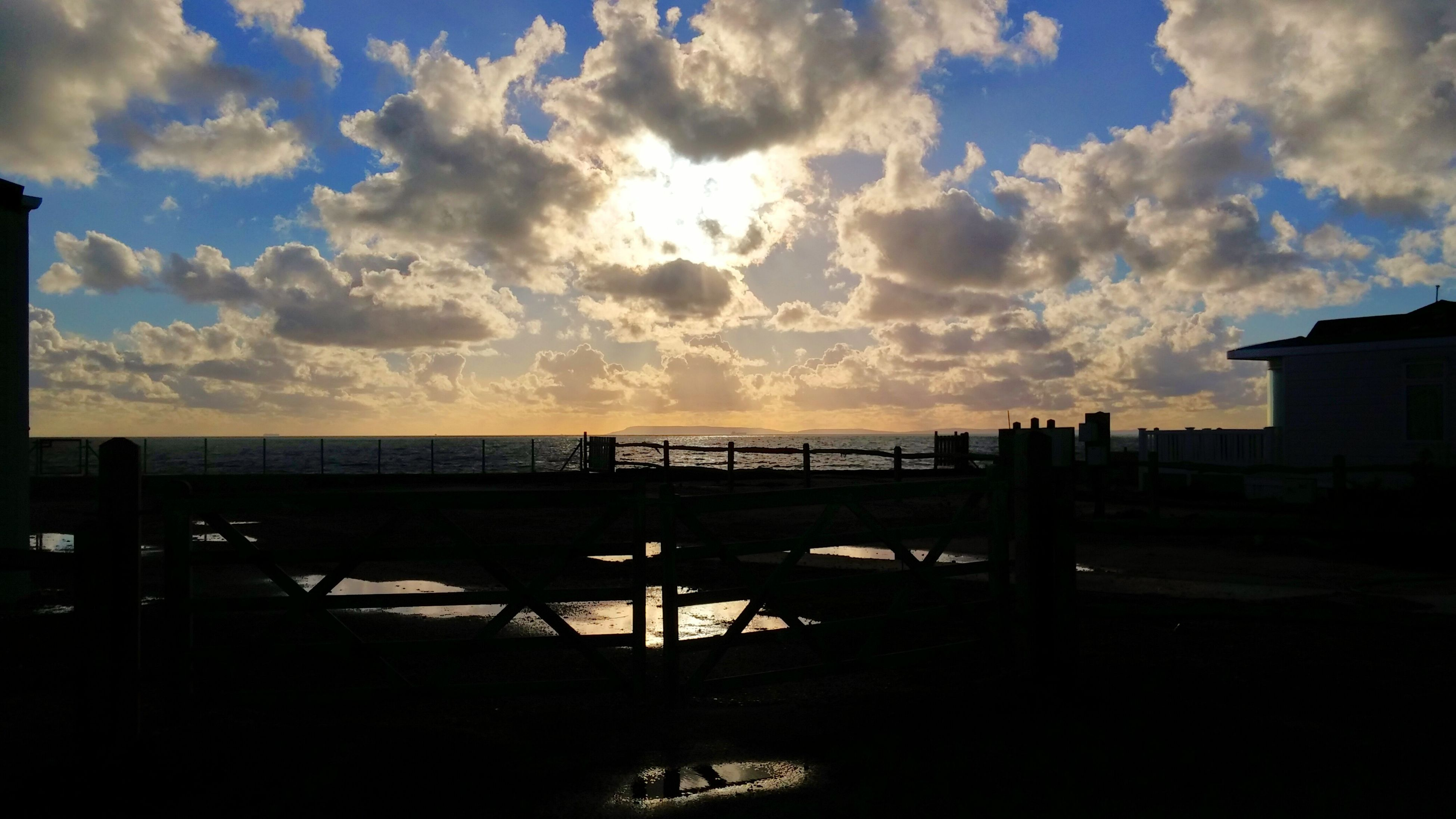 sky, sea, cloud - sky, water, horizon over water, sunset, beach, silhouette, tranquil scene, scenics, tranquility, beauty in nature, cloud, nature, idyllic, cloudy, shore, built structure, sunlight, pier