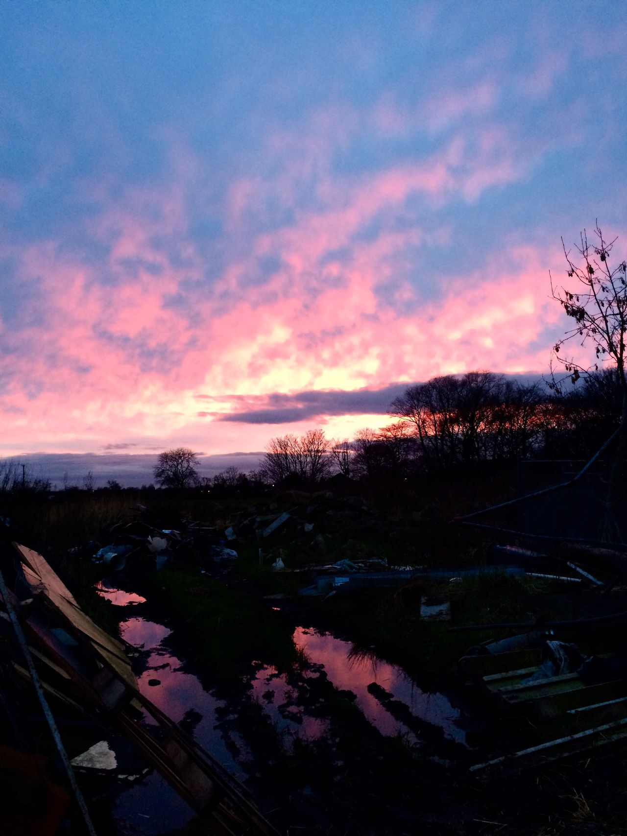 Red sky at night, shepherds delight. RedSky Clouds Puddles Water Stables Waste Rubbish Junk