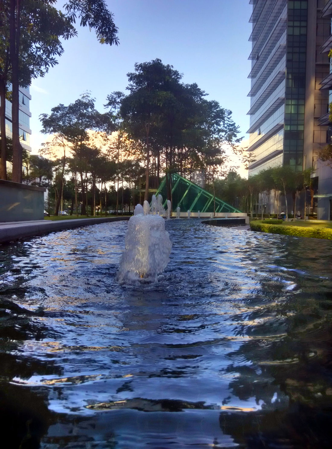 Among the office-blocks there is a small park with jumping water. Architecture Building Exterior Fountain Jumping Water Office Building Outdoors Park Water Waterfront