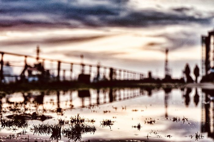 Sky Water Architecture Built Structure Bridge - Man Made Structure River Connection Cloud - Sky Outdoors Focus On Foreground Silhouette No People City Sunset Nature Travel Destinations Building Exterior Day Close-up Puddle Reflections Elbe River Harbour View