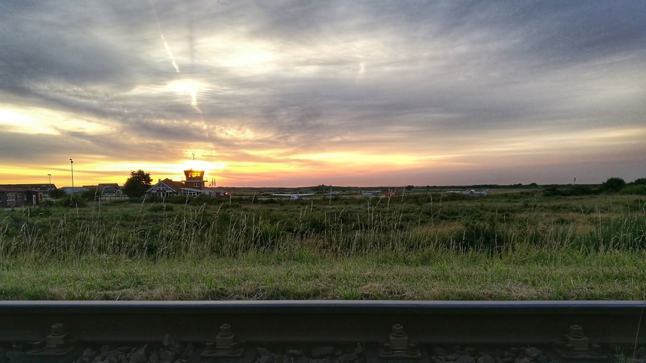 Field Rural Scene Dramatic Sky Sunrise Airfield Airplanes Tower Controltower Outdoors Tranquility Scenics No People Cloud - Sky Day Sky Beauty In Nature Landscape Huawei HuaweiP9 Island Huaweiphotography Langeoog Mode Of Transport Tranquility