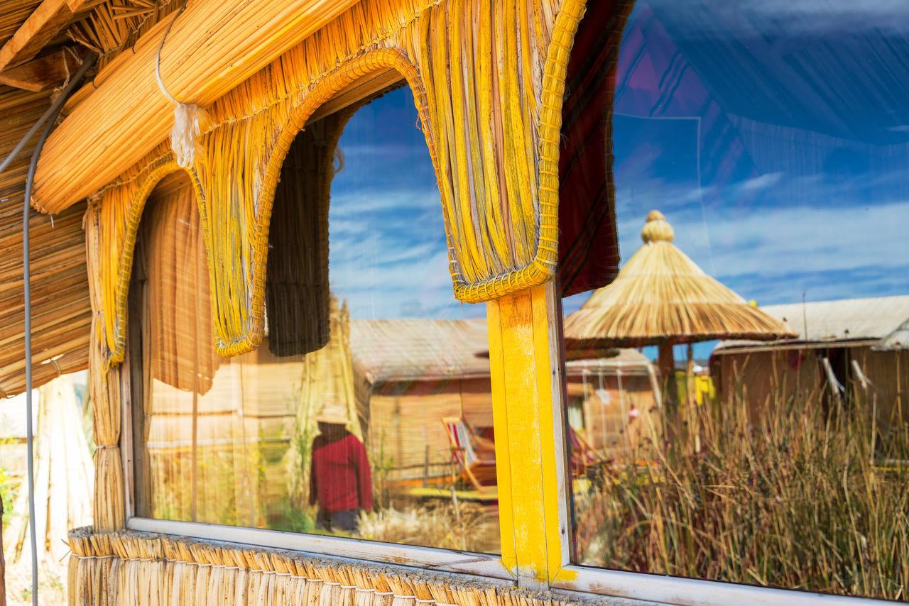 Uros Floating Island reflected in a window on Lake Titicaca, Peru Architecture Aymara Day Floating Indigenous  Island Islands Lake Titicaca Man Man Made Object Manmade Person Peru Puno Reed Reeds Totora Tourism Travel Travel Destinations Uros Uros Island Uros Island - Lake Titicaca Uros Islands Uros Islands - Titicaca Lake