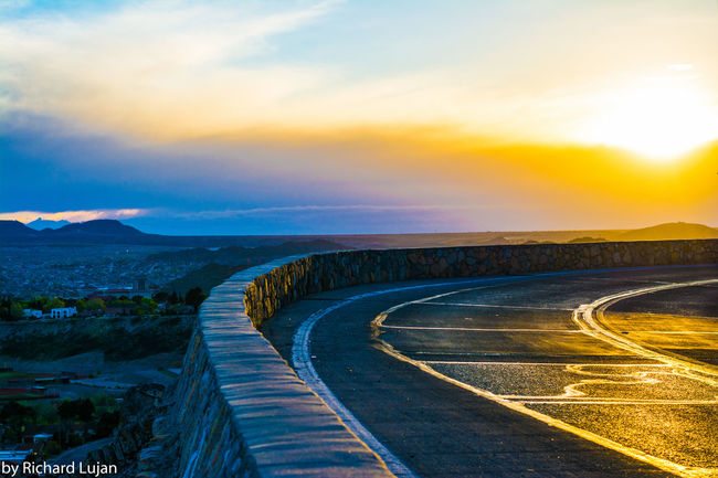 Curve in the Road Curved  Empty Road Landscape Mountain Outdoors Road Scenic Drive Scenics Sky Sunset Surface Level