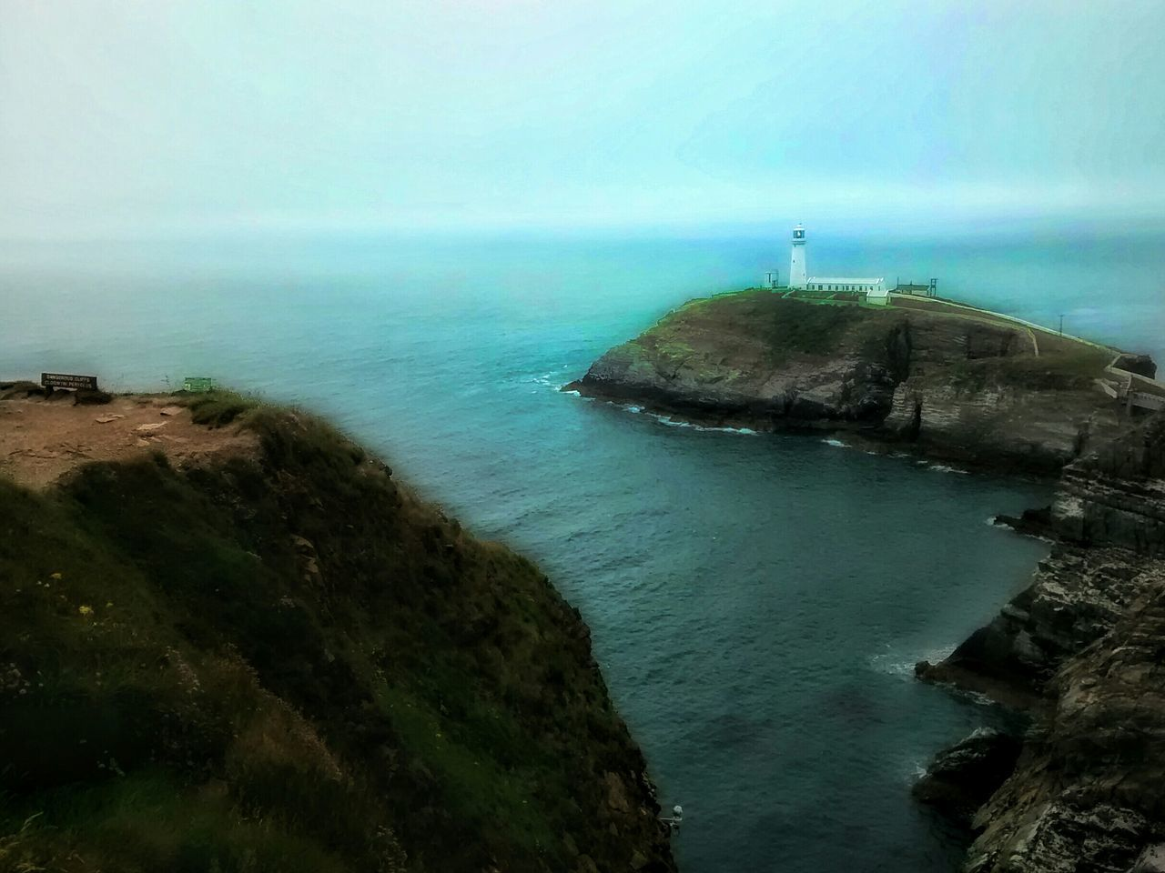 sea, water, built structure, horizon over water, nature, architecture, tranquility, beauty in nature, scenics, day, lighthouse, tranquil scene, no people, building exterior, outdoors, cliff, sky