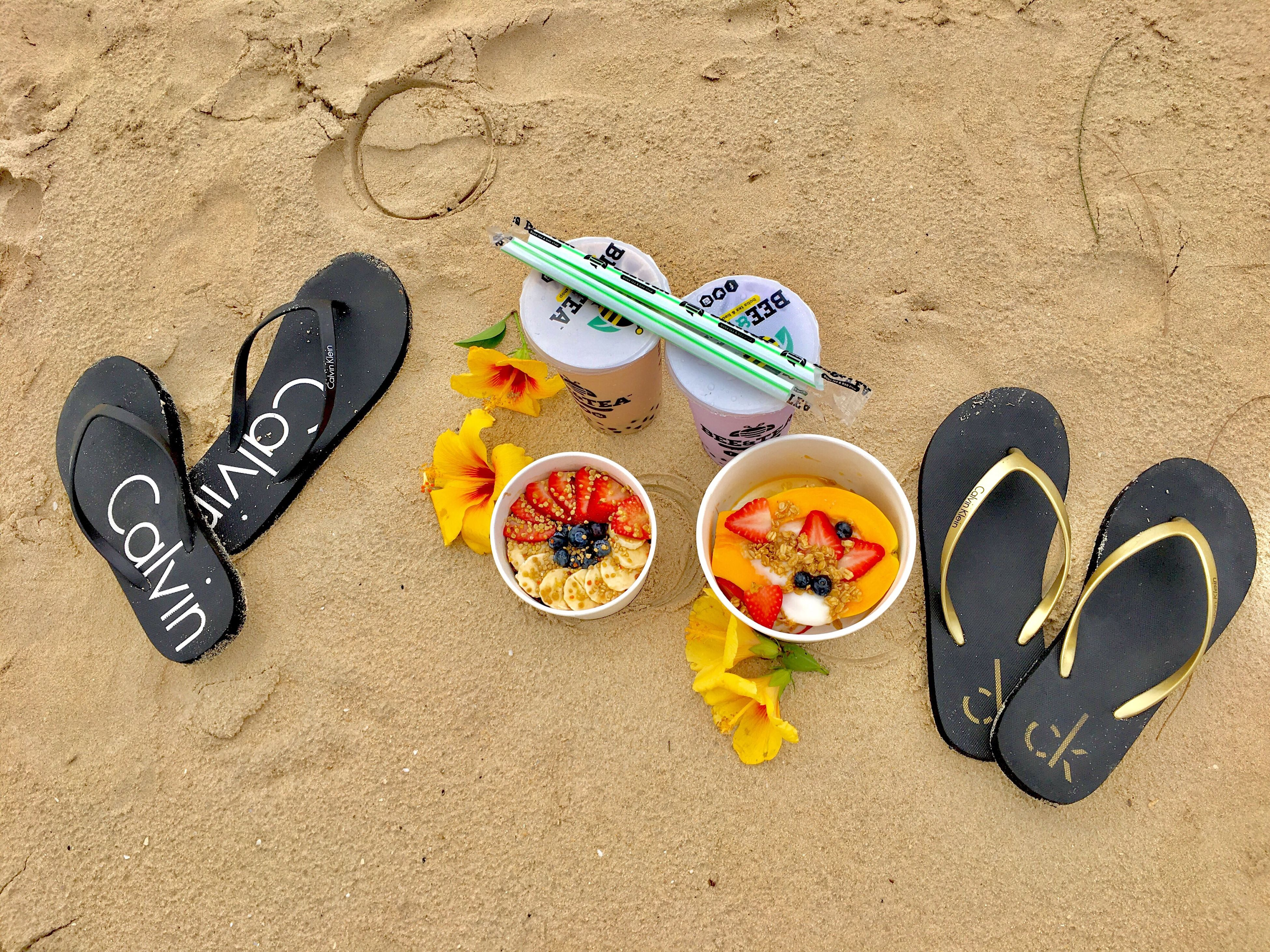 sand, high angle view, beach, portable information device, no people, close-up, outdoors, day