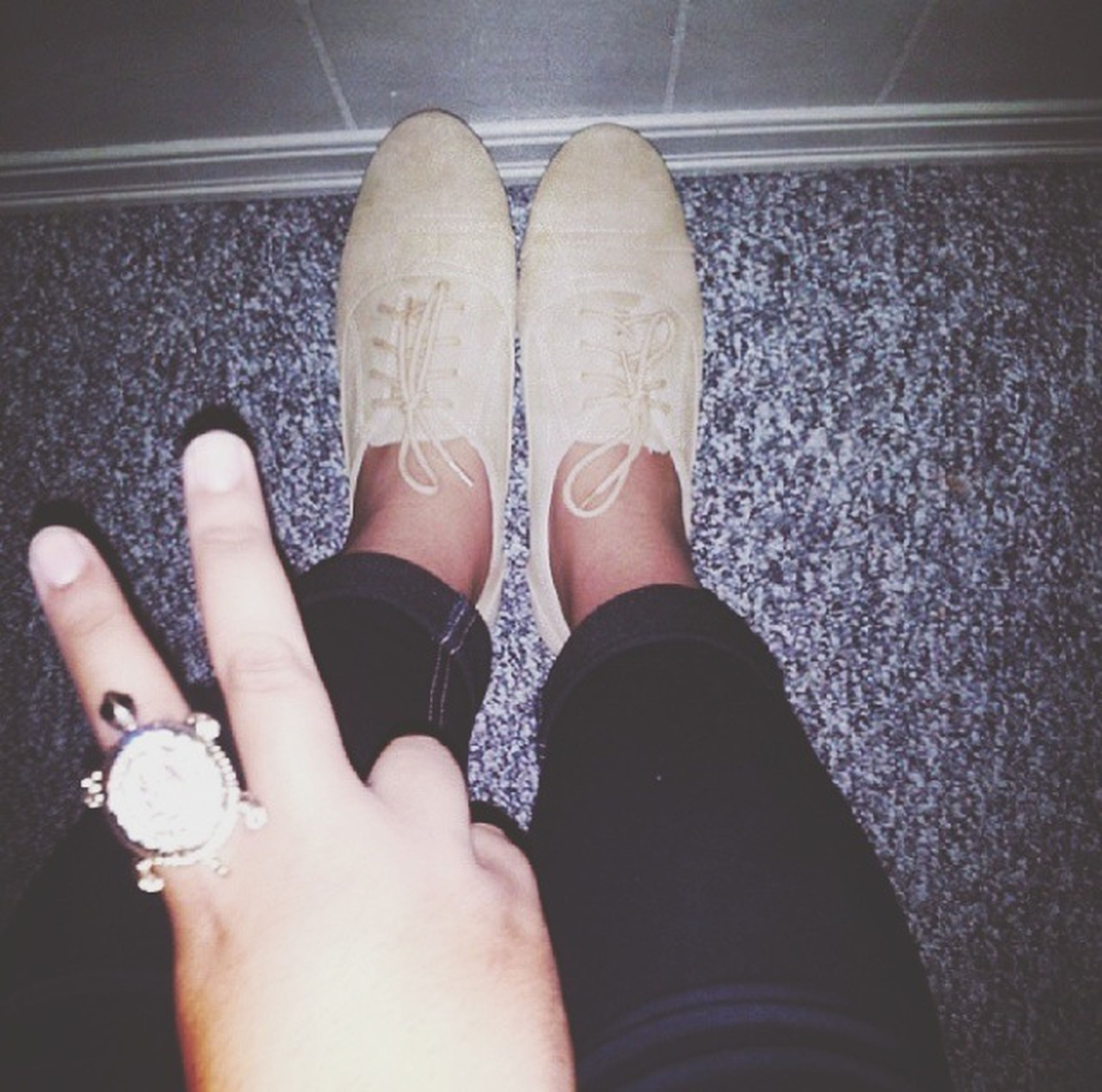 personal perspective, person, low section, part of, indoors, lifestyles, high angle view, shoe, human foot, close-up, leisure activity, footwear, holding, unrecognizable person, human finger