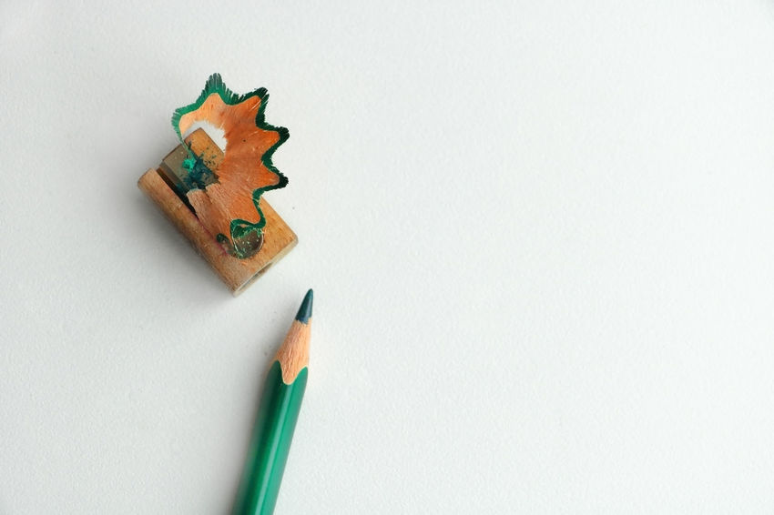 Close-up Copy Space Green Color Growth High Angle View Indoors  Multi Colored No People Pen Pencil Shavings Share Your Adventure Still Life Studio Shot White Background Wood - Material