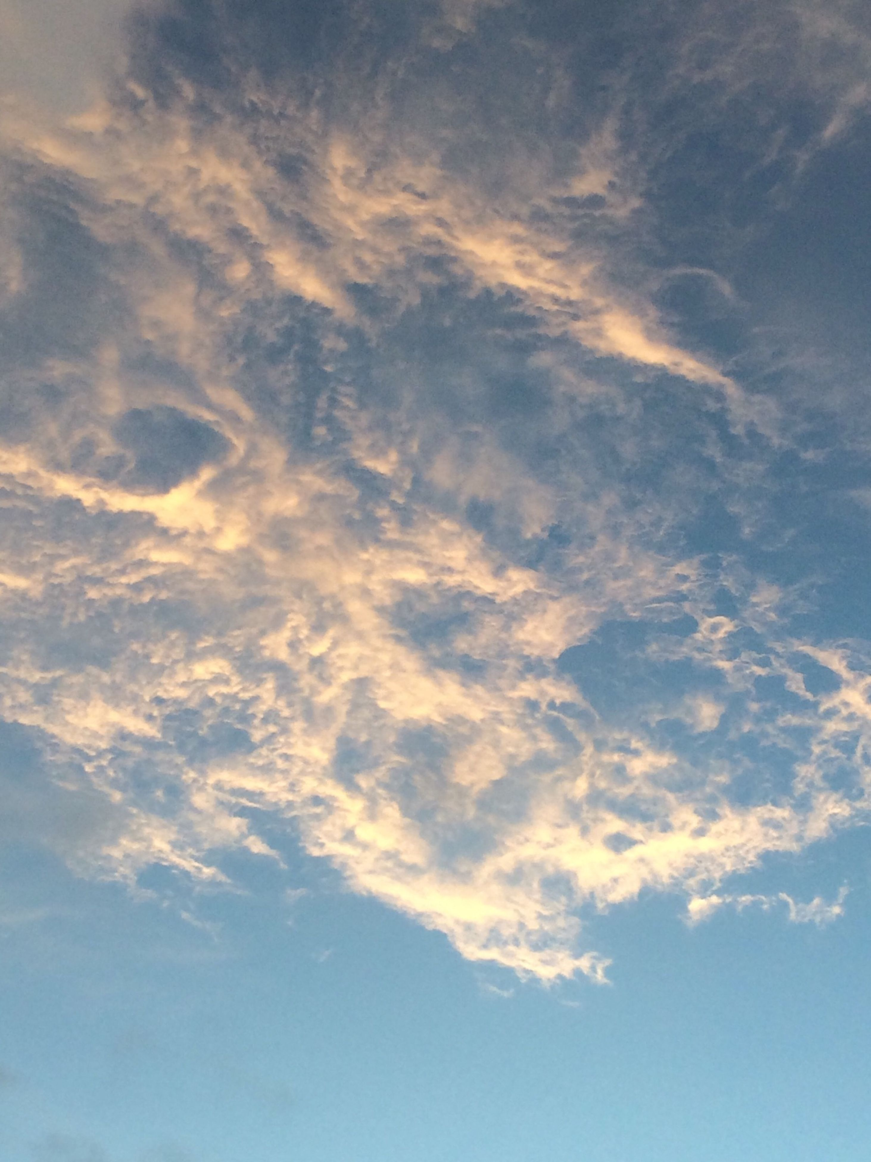 sky, beauty in nature, cloud - sky, tranquility, low angle view, scenics, backgrounds, tranquil scene, sky only, nature, full frame, blue, cloudy, cloud, idyllic, cloudscape, outdoors, no people, day, white color