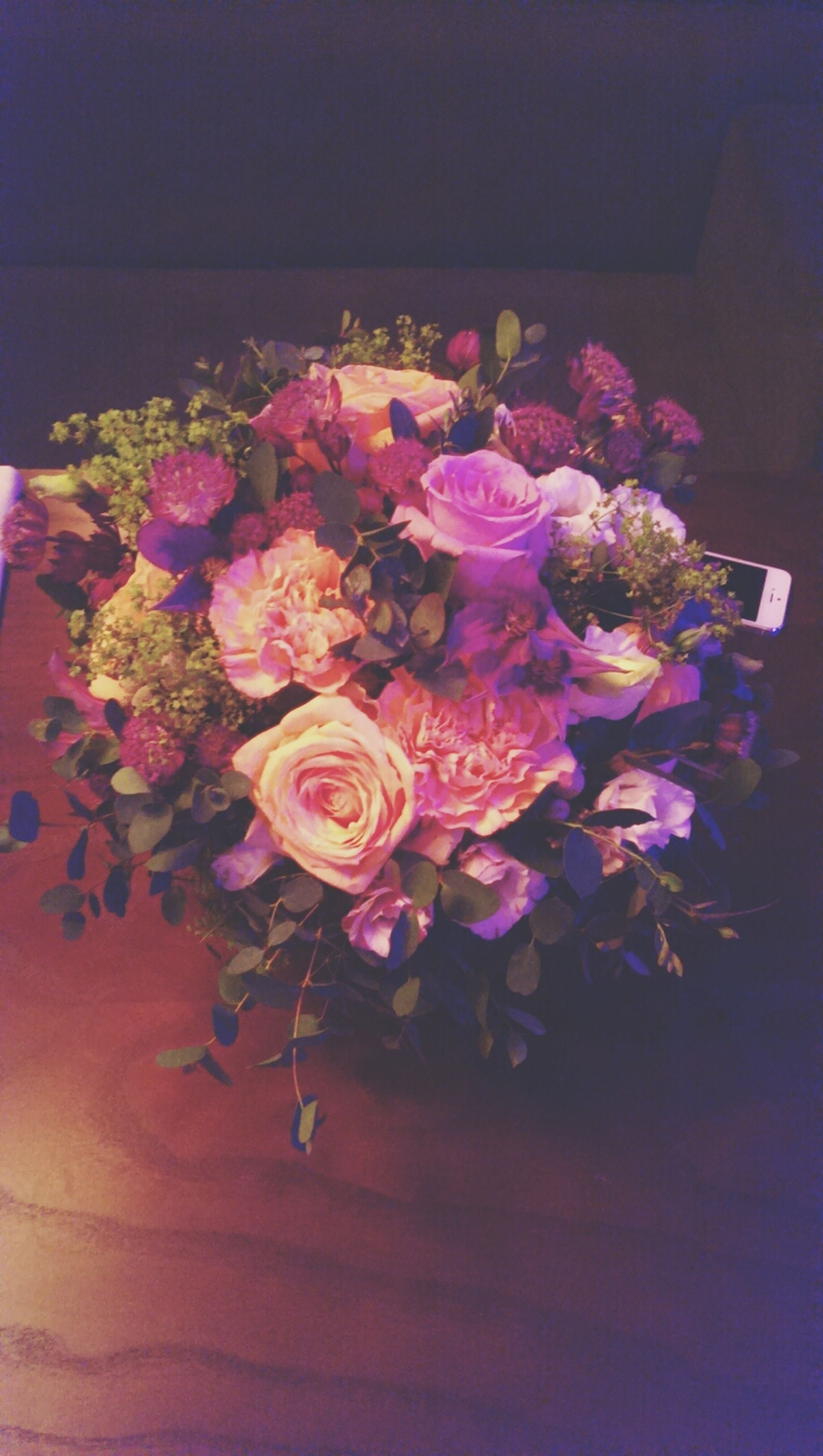 flower, indoors, freshness, petal, fragility, flower head, vase, pink color, bunch of flowers, beauty in nature, bouquet, decoration, close-up, flower arrangement, plant, growth, nature, table, high angle view, purple