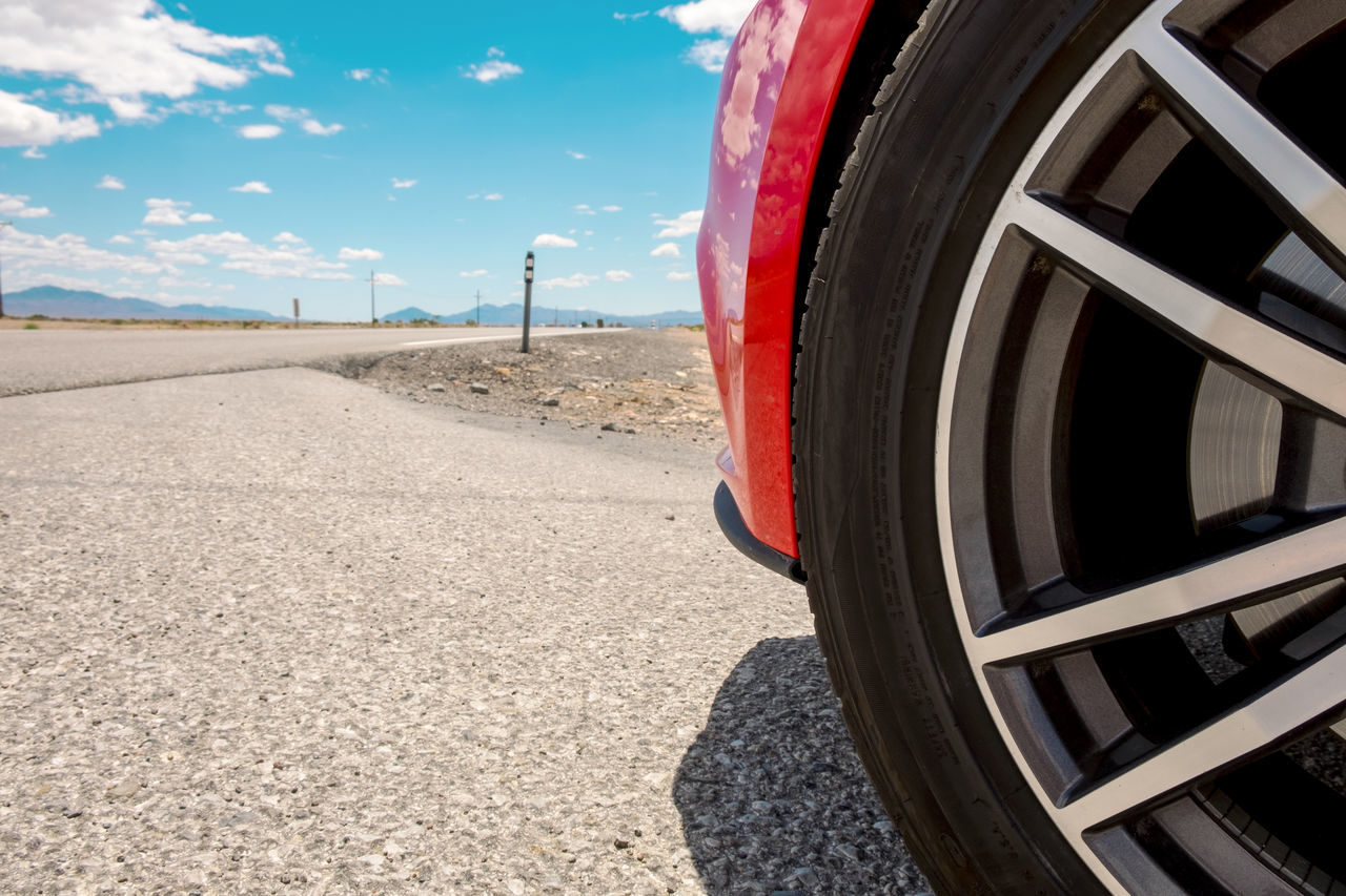 Close-up Copy Space Day Death Valley National Park Heat - Temperature Land Vehicle Loneliness Mode Of Transport No People On The Move On The Road Outdoors Road Sky Sports Car Street Summer Surface Level Tire Tourism Transportation Vacations Wheel Wide