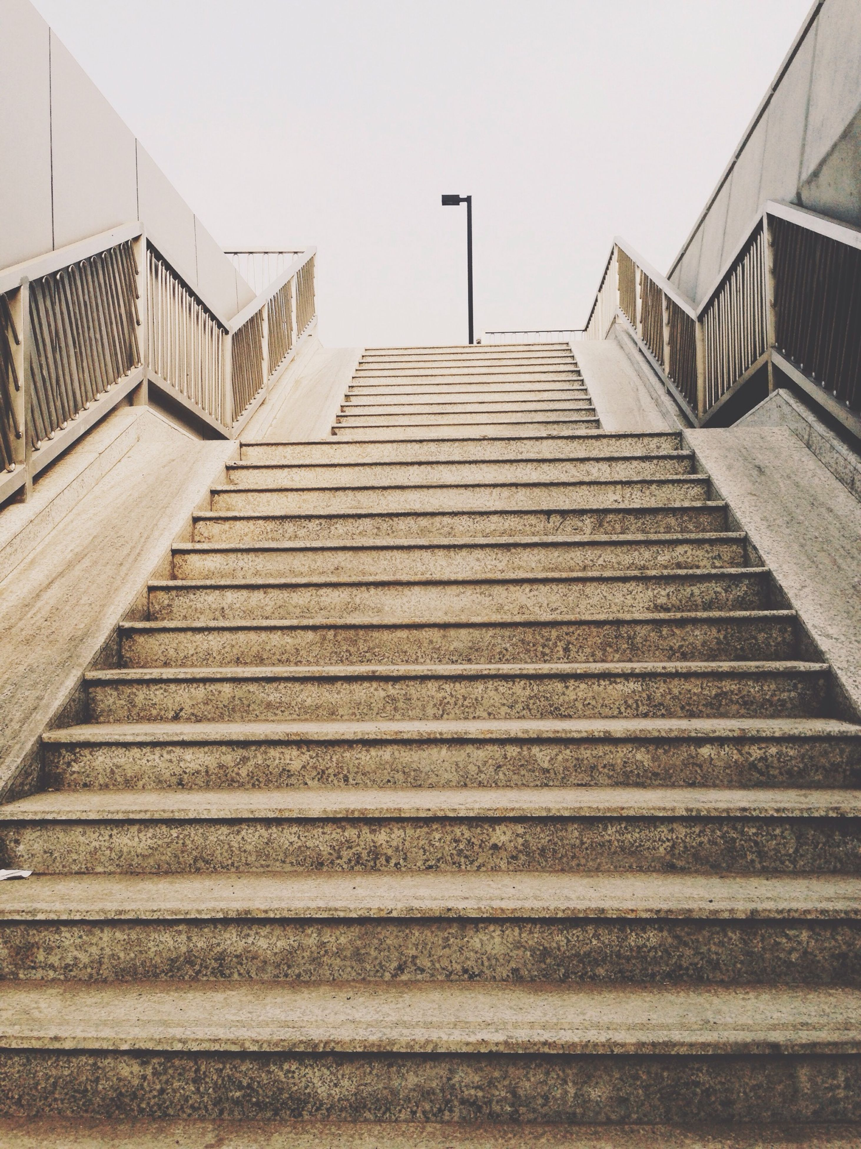 architecture, built structure, building exterior, low angle view, steps, steps and staircases, staircase, the way forward, railing, clear sky, stairs, diminishing perspective, sky, building, day, no people, outdoors, roof, wall - building feature, pattern